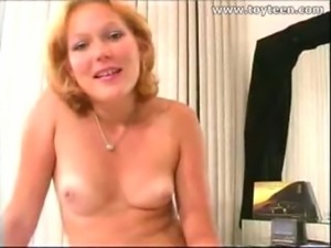 gorgeous shaved girl toying with sybian