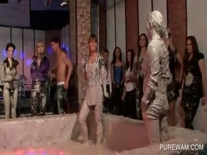 Hot lesbos show their mud covered bodies at a sex party