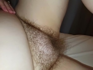 my wife starts to rub her very hairy pussy