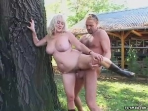 Granny gets fucked in the back yard